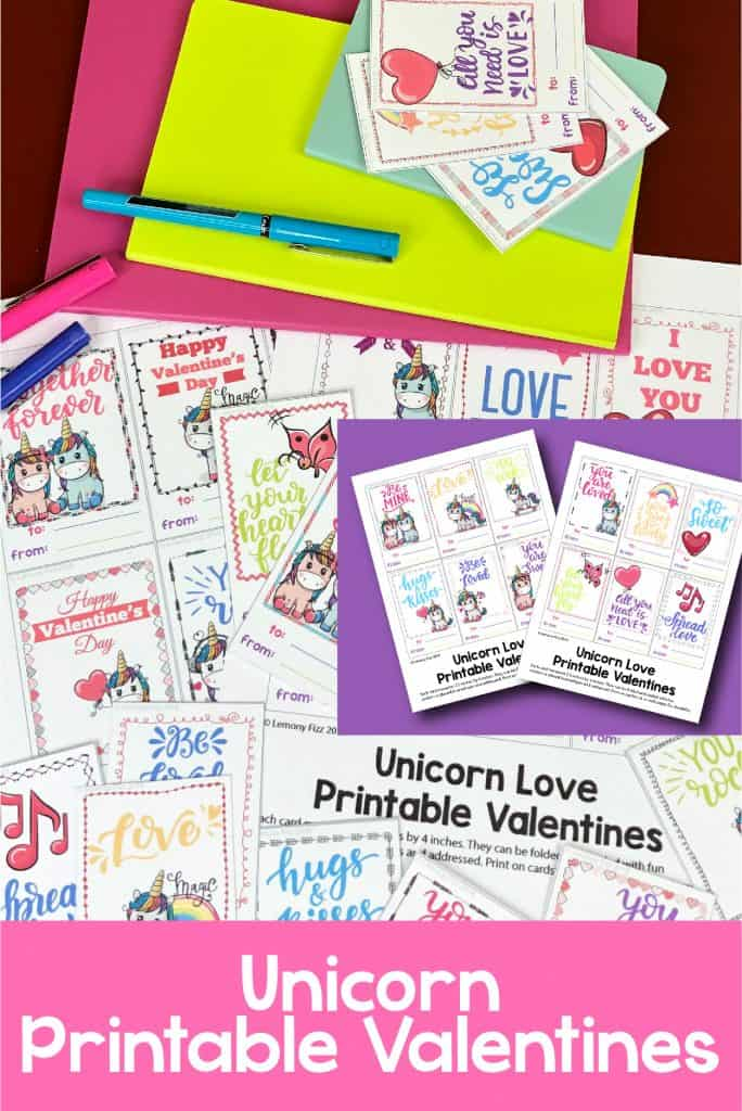 A display of Unicorn Printable Valentines and planners on a table.