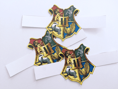 Create Harry Potter crafts with house crests as napkin rings.