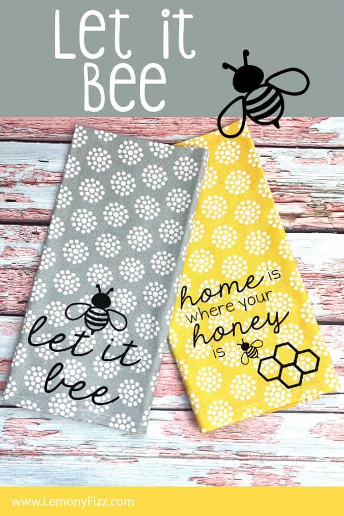 Two tea towels with vinyl bee quotes on a painted background.