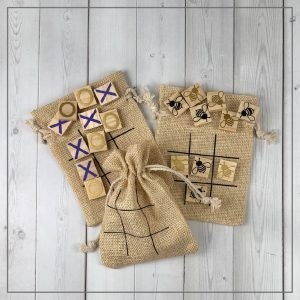 Tic tac toe boards on burlap bags on a white background.