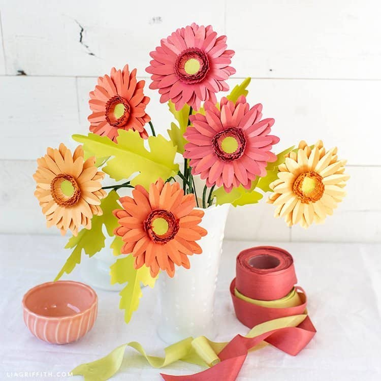 Paper templates for Gerbera Daisy flowers in a white vase with ribbons.