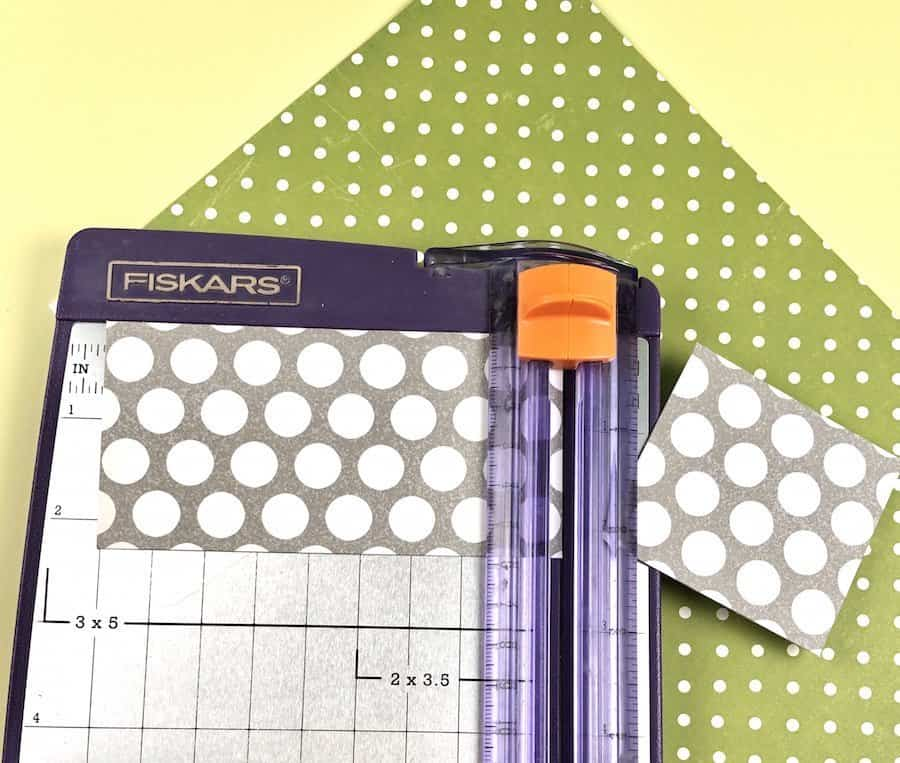 Paper cutter and grey polka dot scrapbook paper.