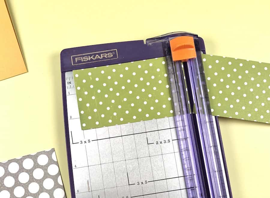 Make a greeting card with paper cutter and grey polka dot scrapbook paper.