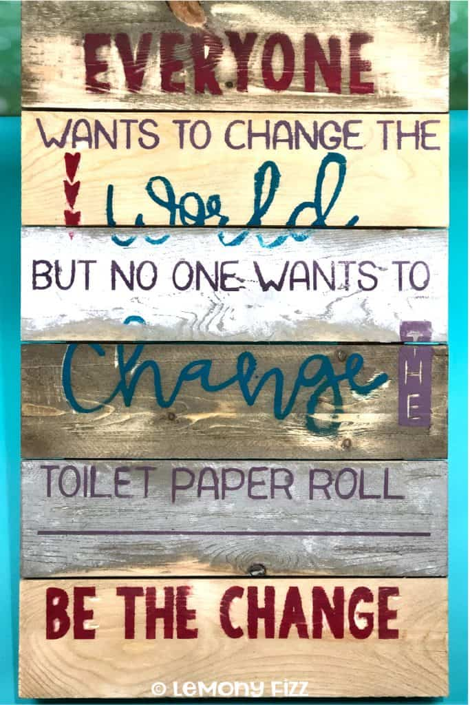A wooden sign with a bathroom quote for home decor.
