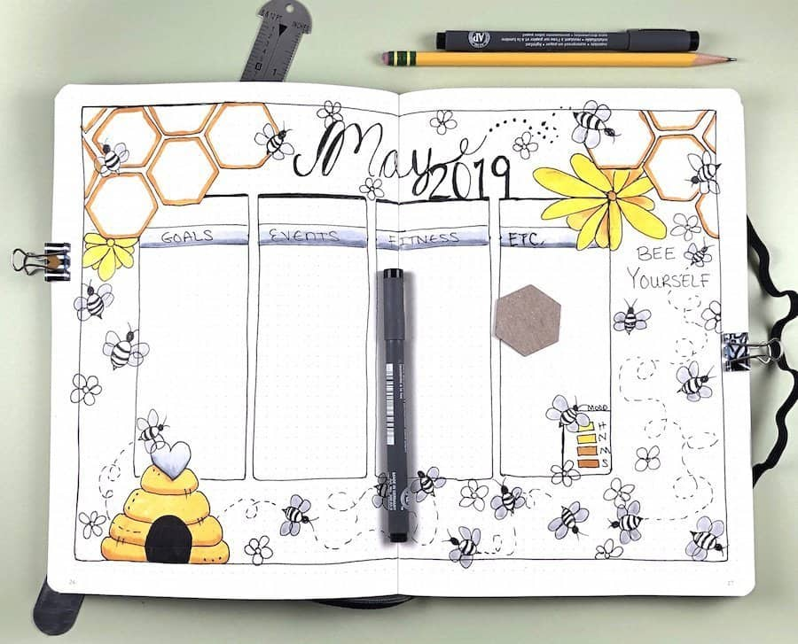 may bullet journal spread with bees and honeycombs