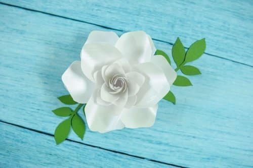 Paper gardenia on a blue background.