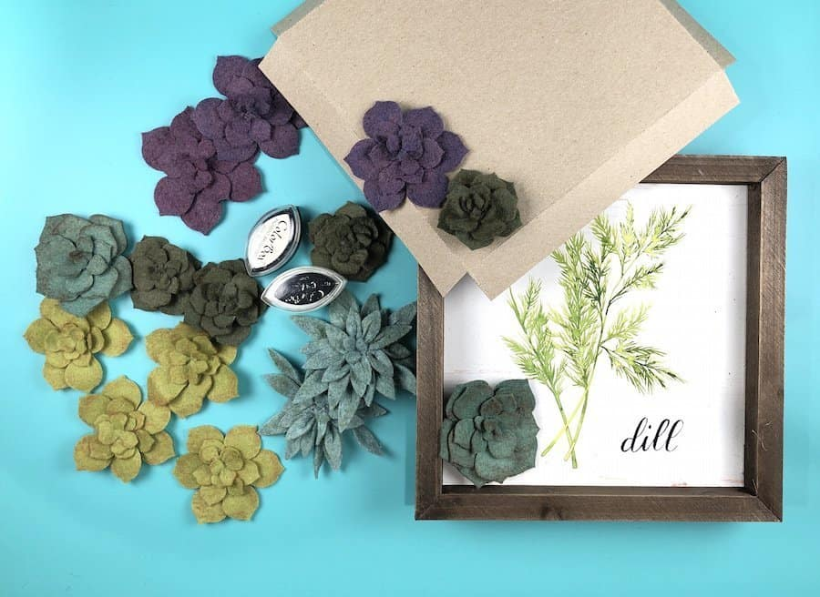 Felt succulents for wall art with cat eye inks and a wall hanging frame.