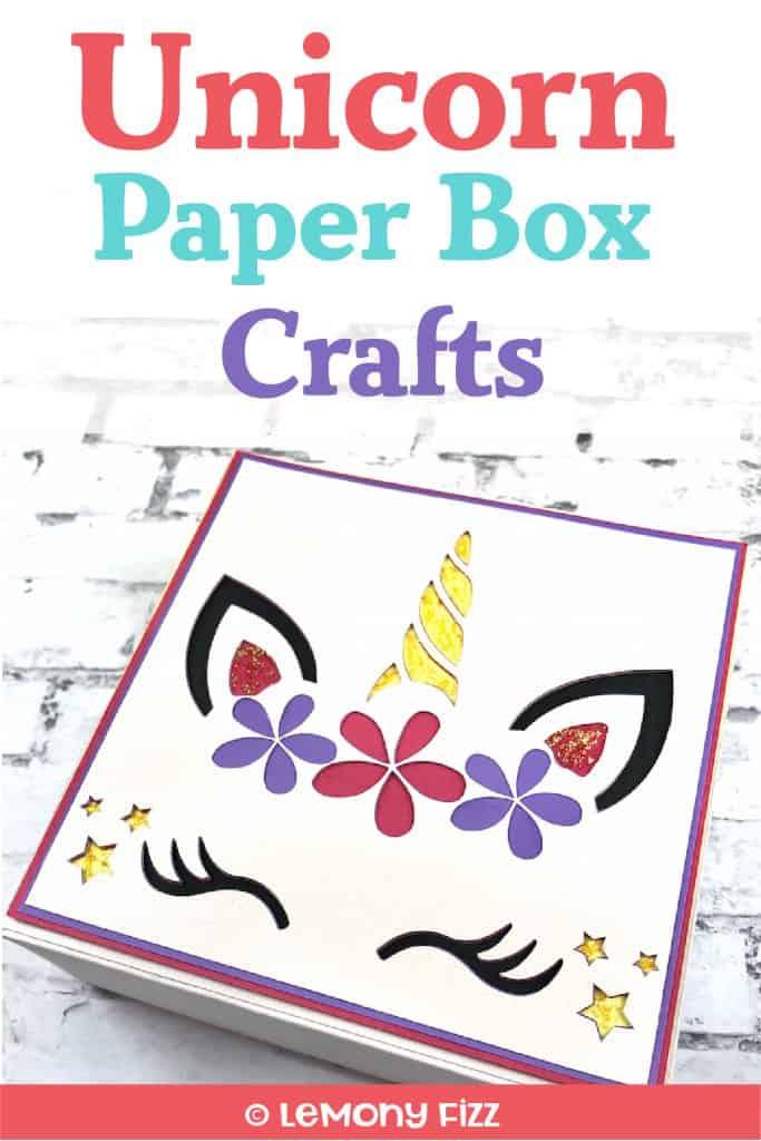 Unicorn paper box on a white brick background.