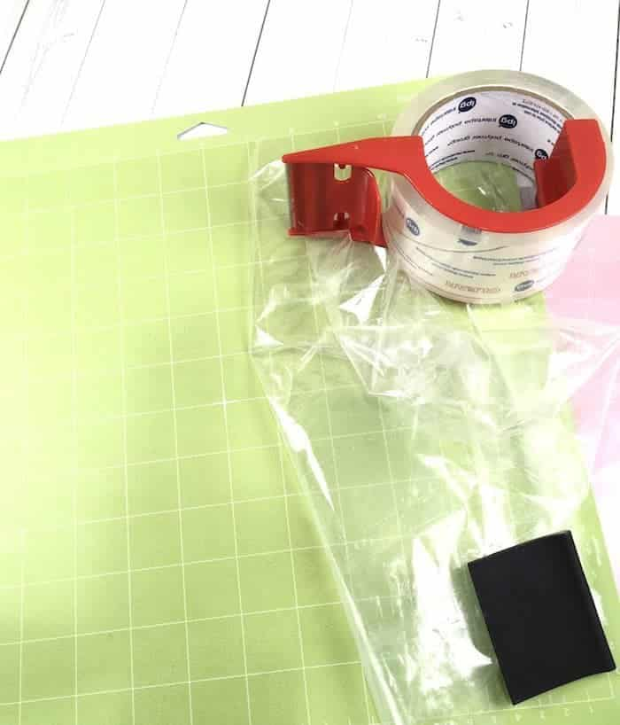 Use packing tape or transfer tape to clean your Cricut cutting mat.