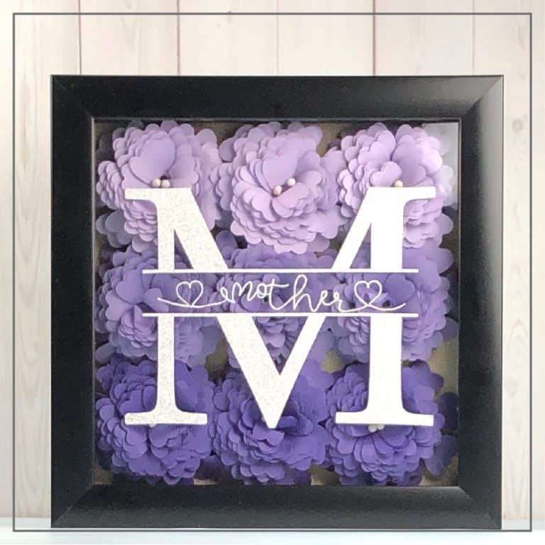 Mother's Day shadow box with rolled flowers and a monogram.