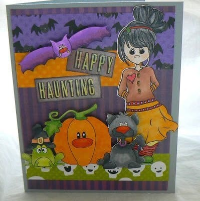 Handmade card with copic marker colored Halloween characters.