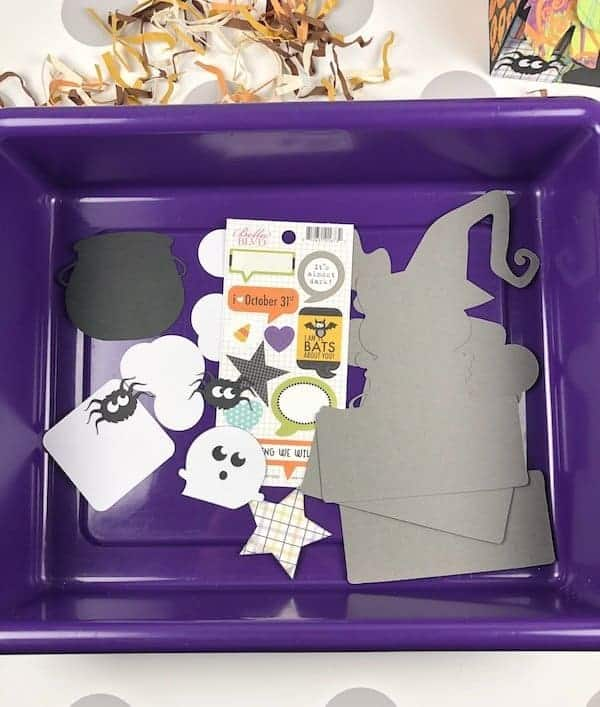 Halloween cat card pieces in a tub to keep track of them.