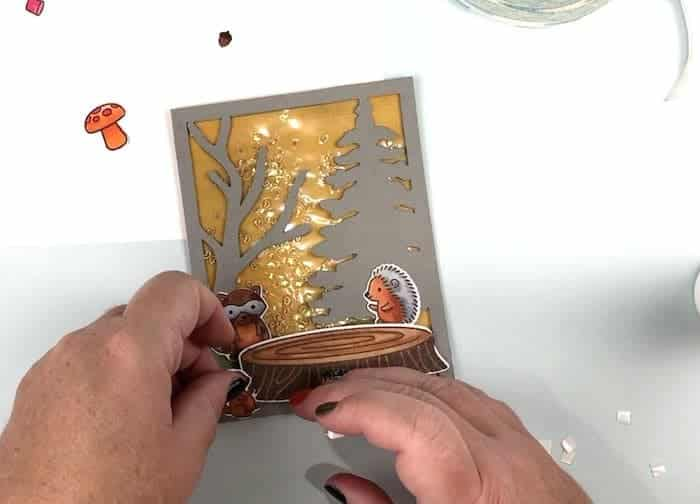 Arrange the forest animals on the card front with 3D foam dots.