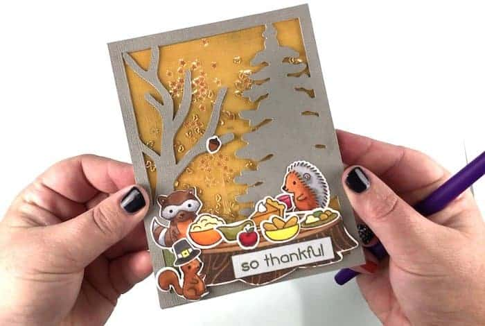 Finished Thanksgiving card with Woodland Animals having a feast.