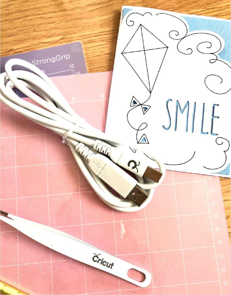 Sample project and cords that come with a Cricut Maker
