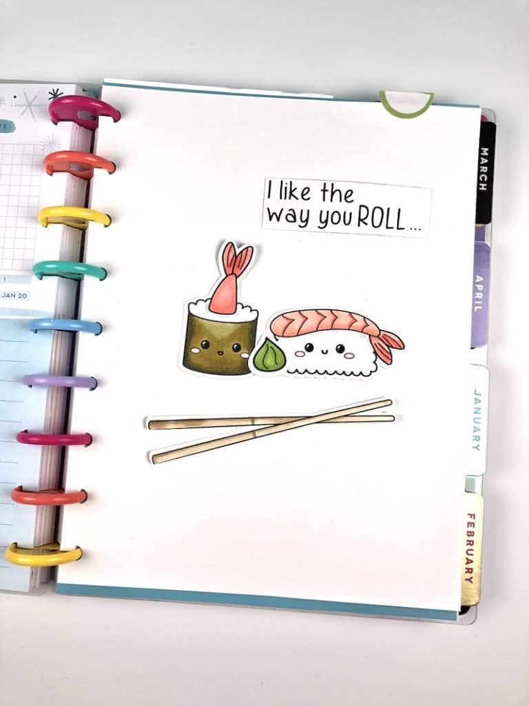 A happy planner insert with planner stickers.