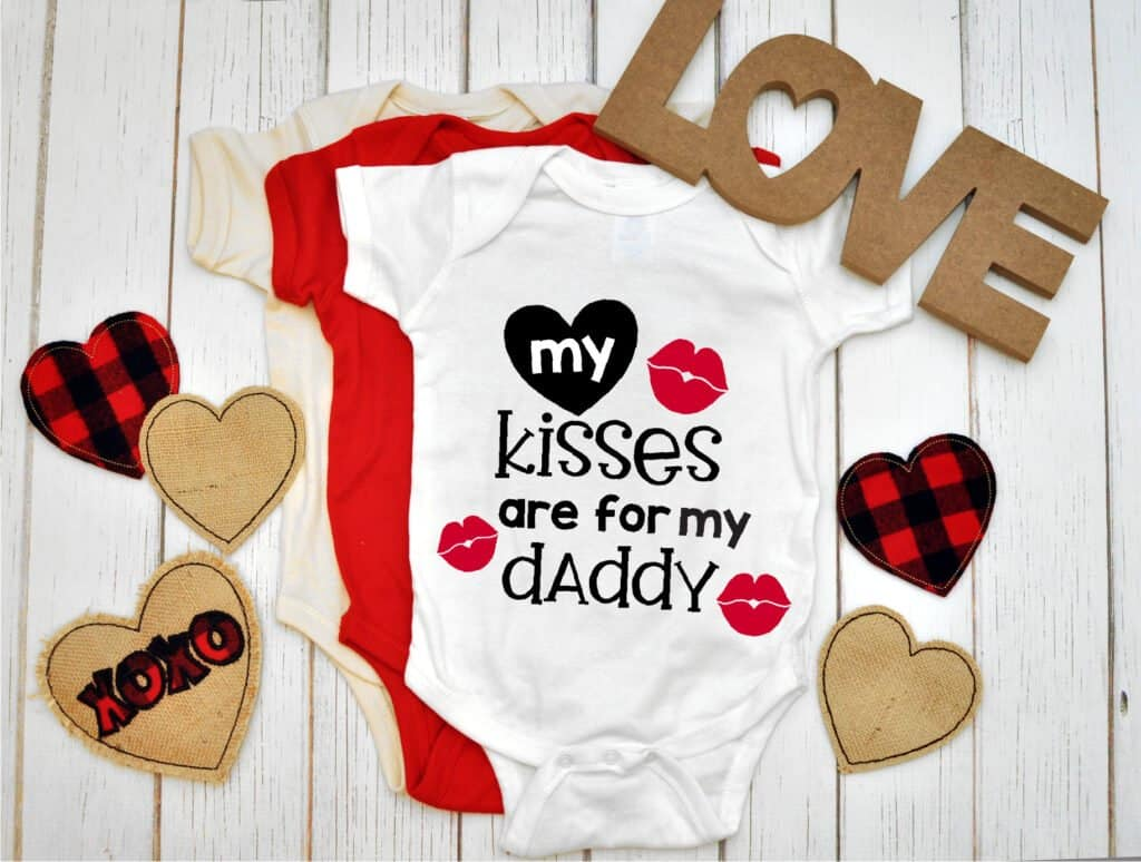 my kisses are for my daddy SVG file on a baby onesie