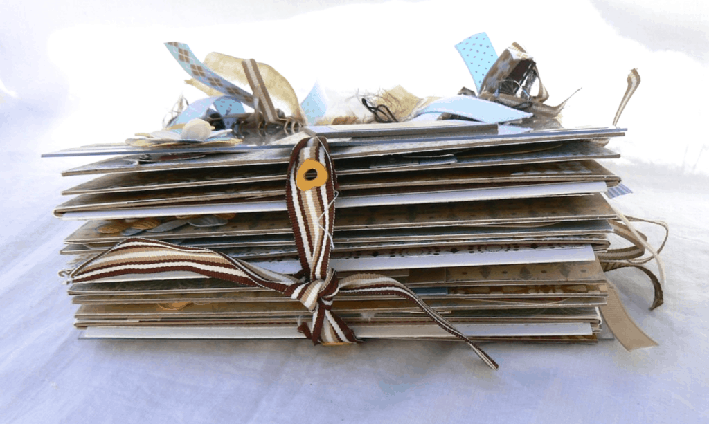 A creative journal with ribbons from the side