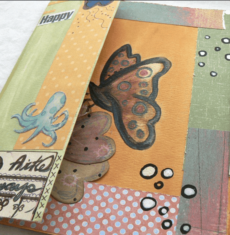 butterfly and octopus on painted creative journal pages
