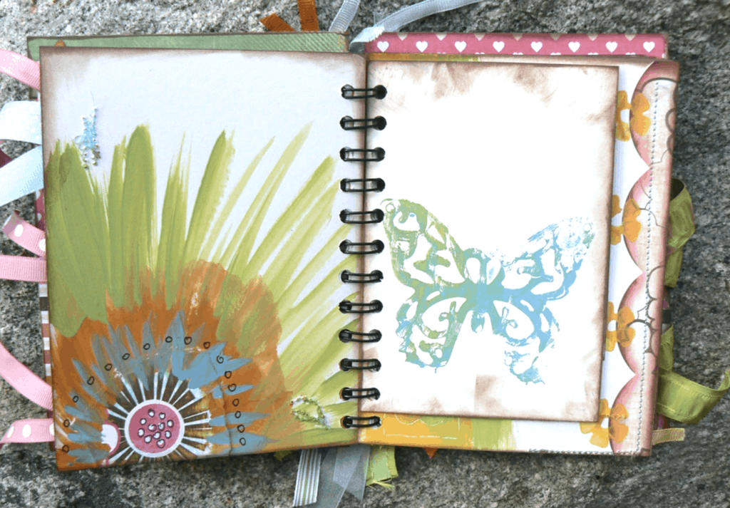 butterfly and paint on a creative journaling page