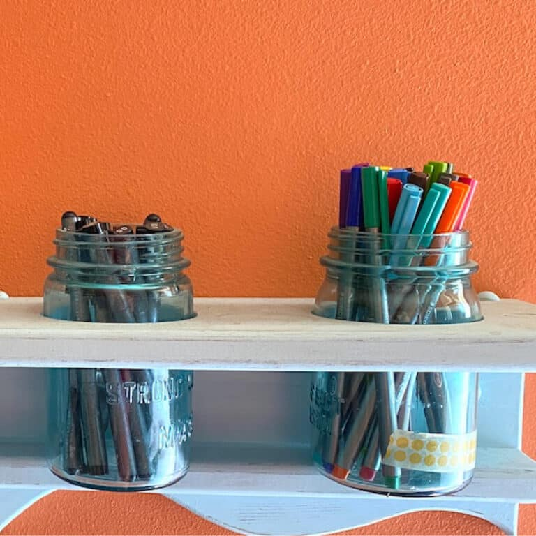 planner pens in blue glass jars