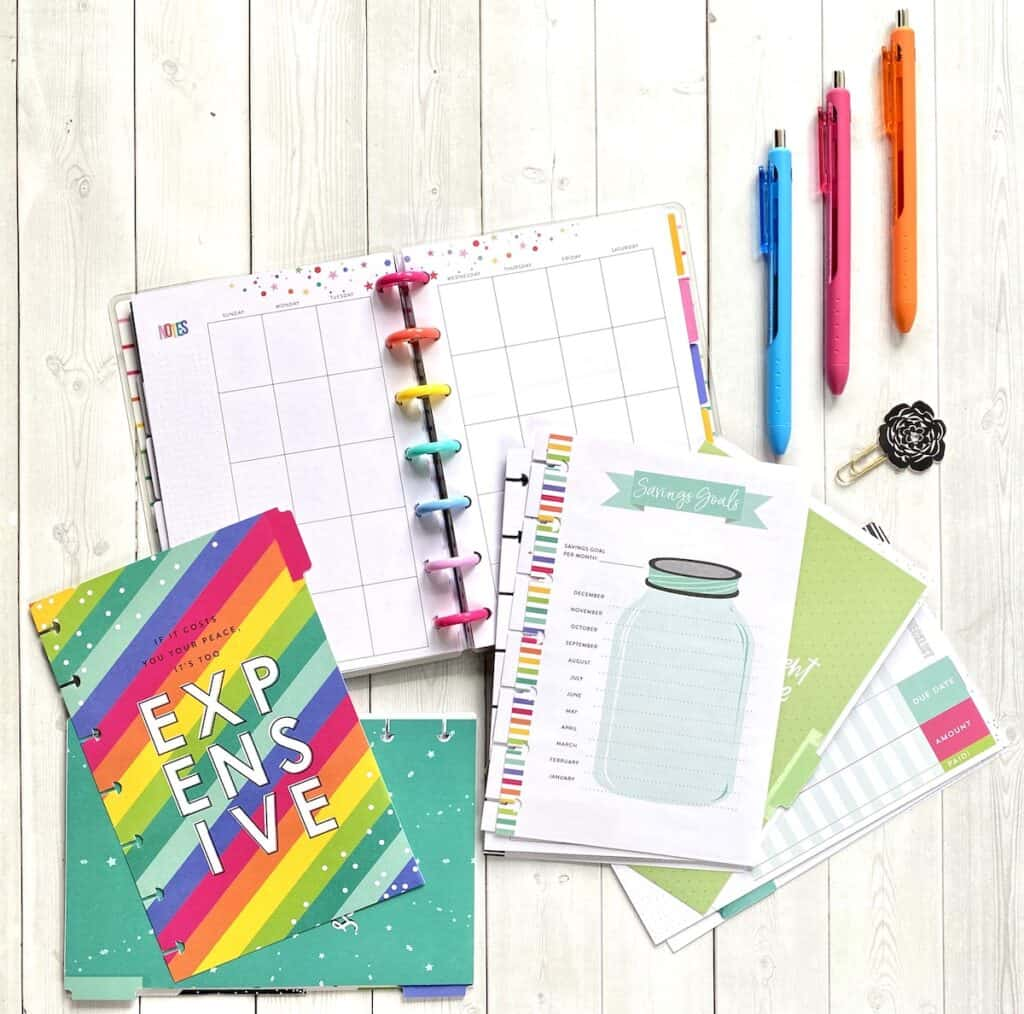Expense planner with savings trackers, pens, and mini Happy Planner