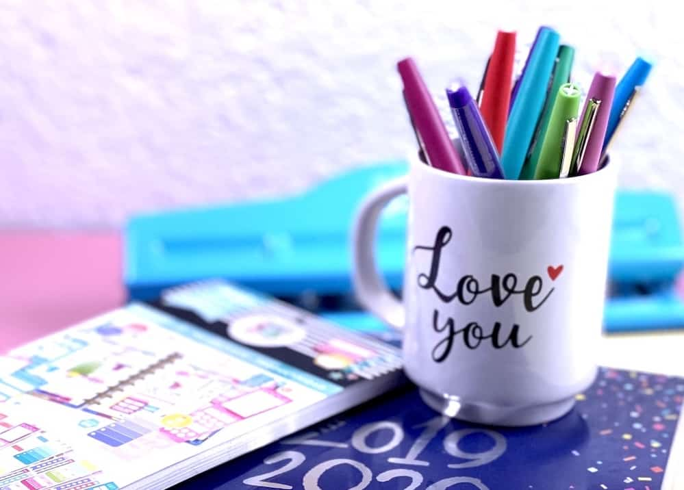 flair pens in an i love you cup with planners