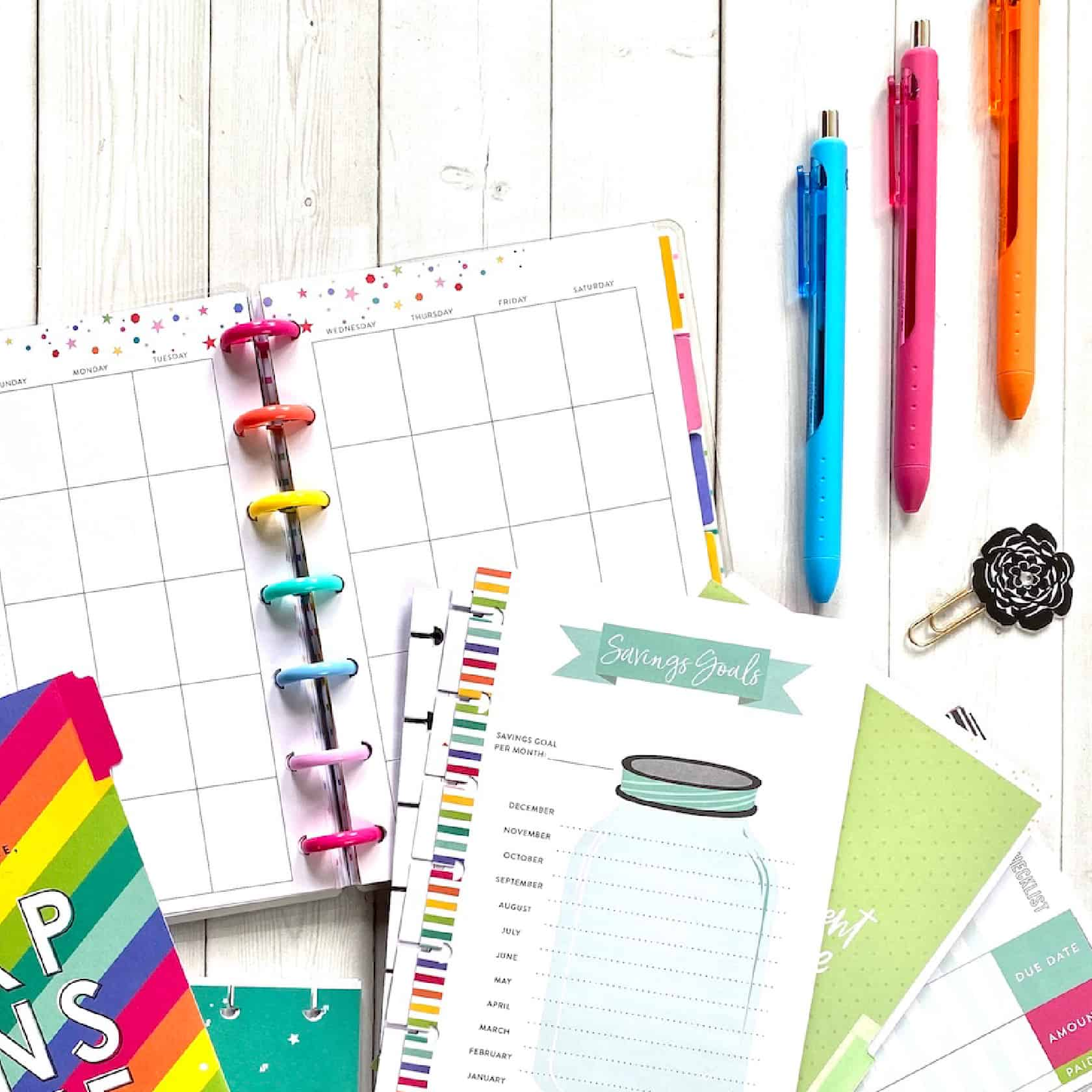 planner productivity with savings trackers and colorful pens