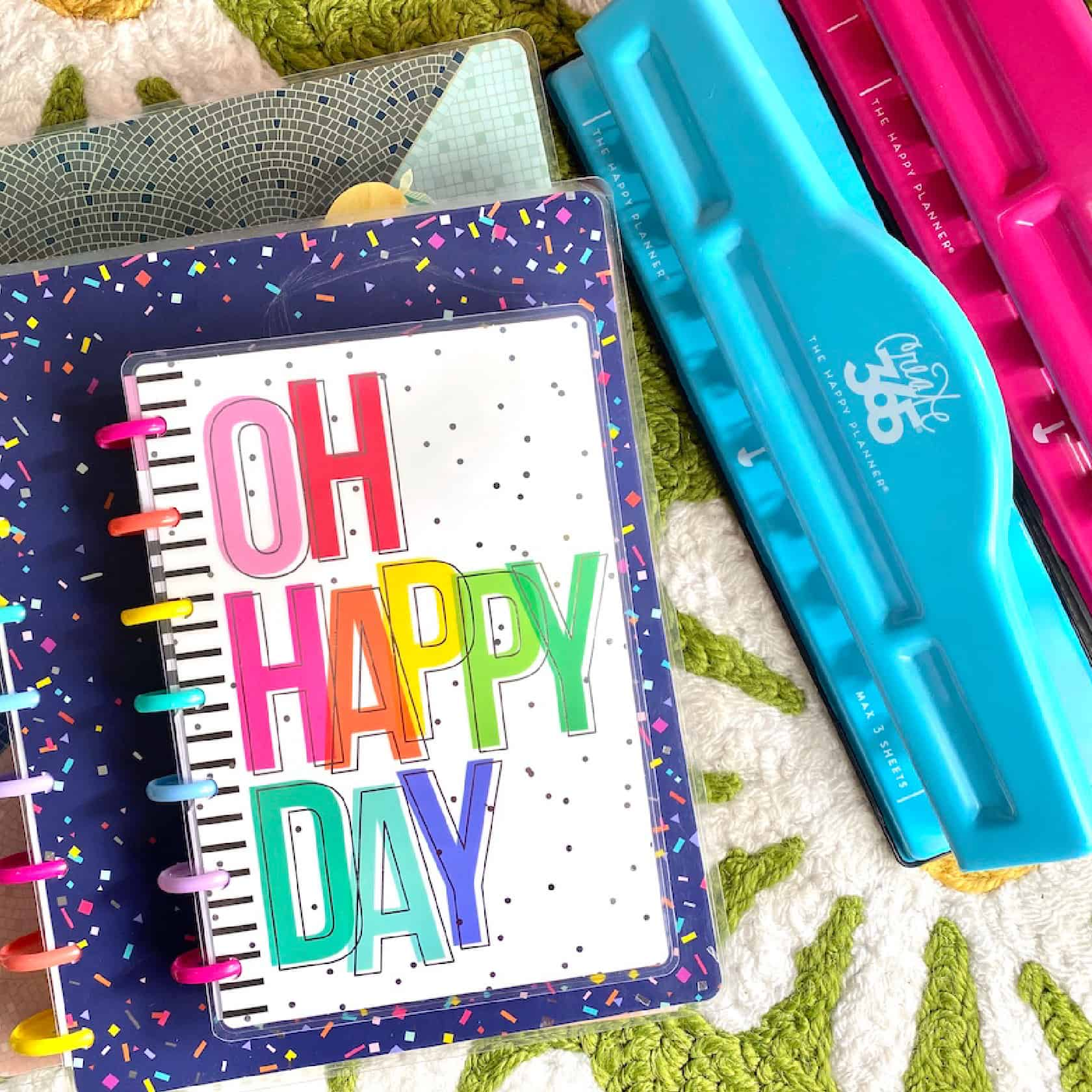 stack of happy planners and planner hole punches
