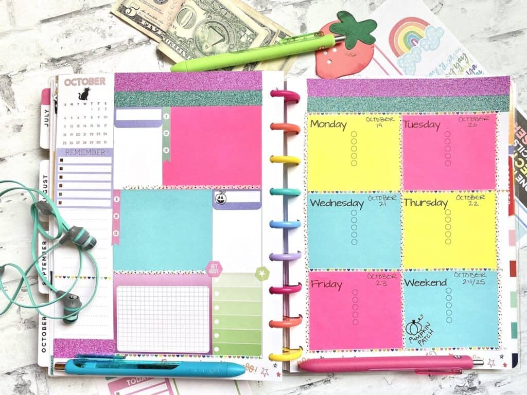 Planner pages with sticky notes, planner stickers, and washi tape.