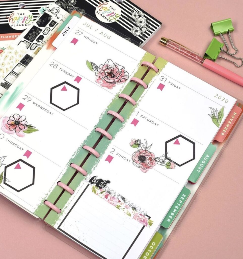 mom and a girl plans skinny planner