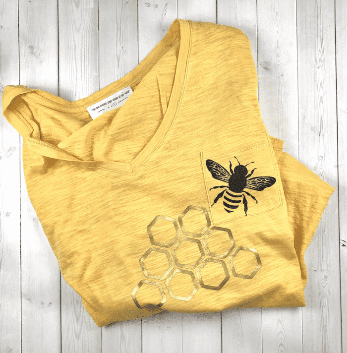 Yellow shirt with bee and honey comb.